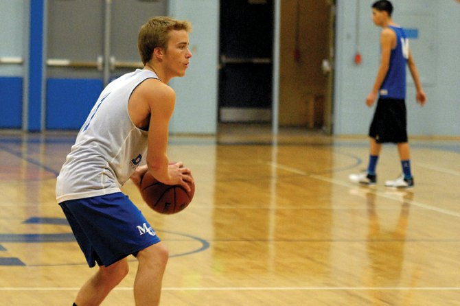 Taft Cleverly, a Moffat County High School sophomore, looks for a pass during practice Nov. 14 at MCHS. Cleverly will help lead the Bulldogs offensive attack from the point guard position this season.