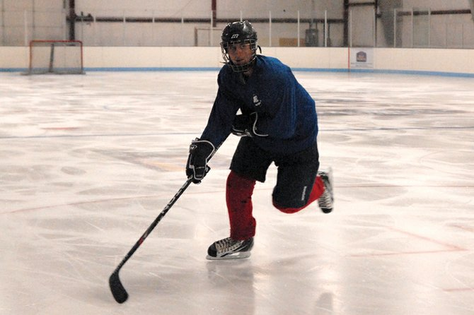 Ethan O'Mailia, a Moffat County High School senior, skates down the ice during practice Nov. 10 at the Moffat County Ice Arena. O'Mailia will be the Moffat County Bulldogs club hockey team's captain this season and said he hopes to keep the team from big letdowns during games.