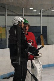 Rick Villa, left, talks to goalie Trent Parrott during practice Nov. 10 at the Moffat County Ice Arena. Rick took over for Mark Samuelson this season and said the teams hustle will decide a lot of games.
