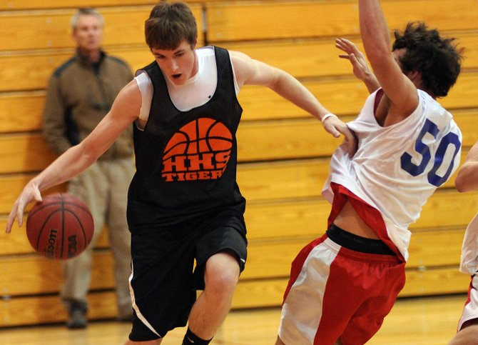 Hayden junior Mark Doolin rumbles toward the hoop Saturday as the Tigers scrimmaged against Steamboat Springs. Doolin is Hayden's leading returning scorer, and one of two experienced low-post players upon which the team may rely this season.