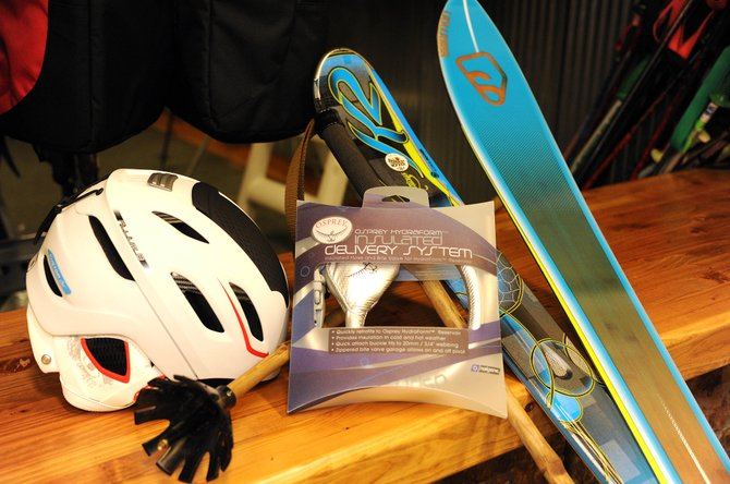 A whole lot of new and a little bit of old are available at Ski Haus. The Salomon Custom Air helment, $180, includes an air pump system as well as a giant always-open vent on the top of the head that ushers heat out without letting cold in. The K2 SuperStitious ski, left, for $729.95, and the BBR 8.9, $699.95, include the newest in ski design. The Osprey insulated delivery system is a new product welcome by fans of the hydration system. The RaBamboo Ninja Grip poles, meanwhile, turn the page back, doing away with metal ski poles in favor of bamboo, for $95.