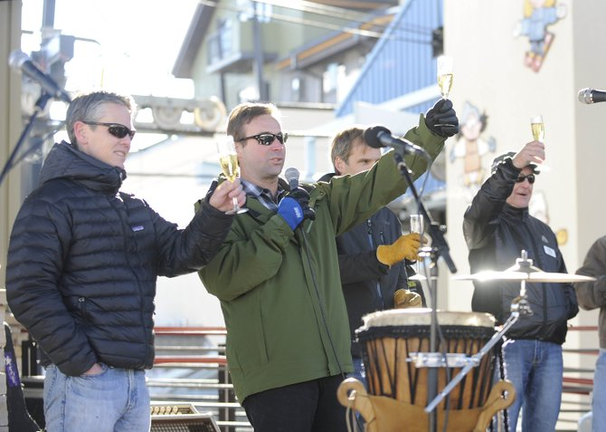 Urban Renewal Area Advisory Committee co-chairmen David Baldinger Jr., left, and Steve Frasier raise their glasses of Champagne during a celebration of the completion of construction projects at the base of Steamboat Ski Area.
