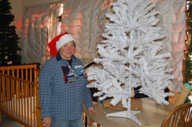LaDeana Cook gets into the holiday spirit early while working at the Community Budget Center, 555 Yampa Ave. Cook, 47, is originally from Texas and has worked at the CBC for about eight years. She said she is already anticipating spending Christmas with her children and grandchild.