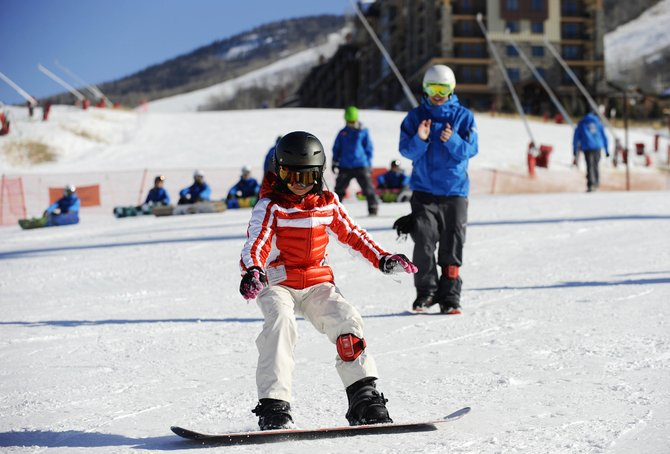 Steamboat Ski Area snowboard school instructor Aaron Kinslow follows 11-year-old Lilian Do, of Houston, during a lesson Tuesday. The ski area is proposing to build a gondola that would access a new learning center at the Bashor Bowl.