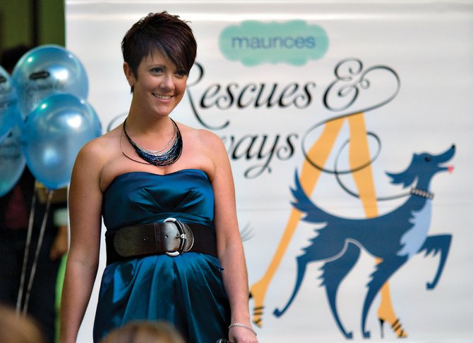 Jessica McGuinness steps onto the walkway during the 2009 Rescues and Runways fashion show at Centennial Mall. A pet adopt-a-thon kicks off this year's event at noon Saturday at the mall, followed by a silent auction at 1 p.m. and the fashion show at 2 p.m.