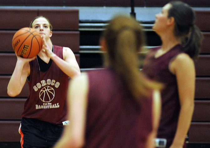 Soroco senior Lindsay Miles, left, takes aim Wednesday during basketball practice. The Rams kick off their season at 4:30 p.m. Thursday at home against North Park.