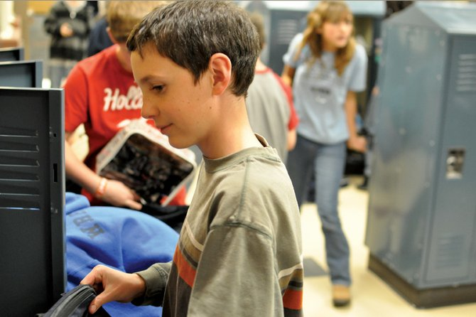 Grant Wade, 11, a Craig Middle School sixth-grader, grabs his backpack from his locker at the end of school Wednesday. The Moffat County School District has brought in KL&A, Inc., a structural engineer and building firm out of Golden, to conduct an independent review of the middle school's structural integrity. The Neenan Co., the general contractor for CMS construction, has recently come under scrutiny after structural issues were discovered at other schools the company built in Colorado.