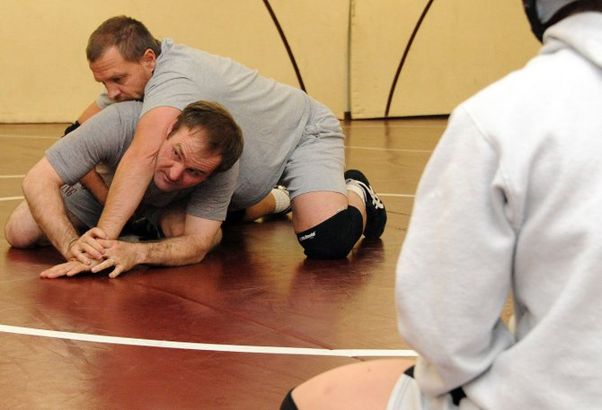 Soroco wrestling coaches Jay Whaley, bottom, and Travis Bruggink show off moves Thursday during one of the Rams' final practices before Saturday's season-opening meet at Middle Park High School. All three Routt County high school teams return experienced, state-contending wrestlers this season.