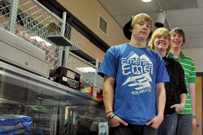 From left, Moffat County High School seniors Patrick Thompson, Thomas McCoy and Adam Foster stand Thursday in the store run by the high school's Distributive Education Clubs of America group. They're among 26 students going to a DECA district competition Sunday and Monday in Aspen, which determines which competitors advance to state.
