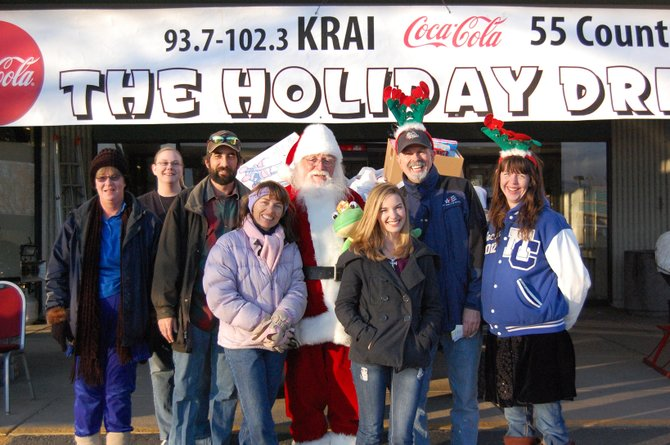 The volunteers of KRAI's Holiday Drive stand in front of a truckload of donated toys Thursday afternoon. Toys, food and money received during the drive will go toward several local charities for the Christmas season. The two-day event raised more than $24,000, surpassing last year's amount by more than $1,000.