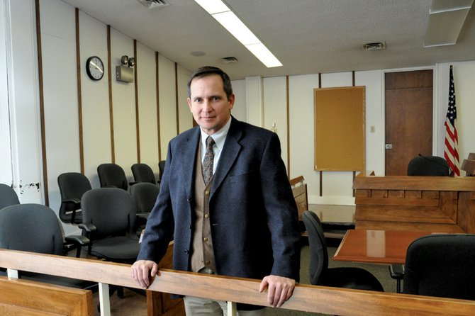 Brett Barkey, assistant district attorney for the 14th Judicial District, stands Monday afternoon in a courtroom at the Moffat County Courthouse. Barkey is more than three months into his second stint with the 14th Judicial District. He worked as Moffat County's chief deputy district attorney until March 2008.