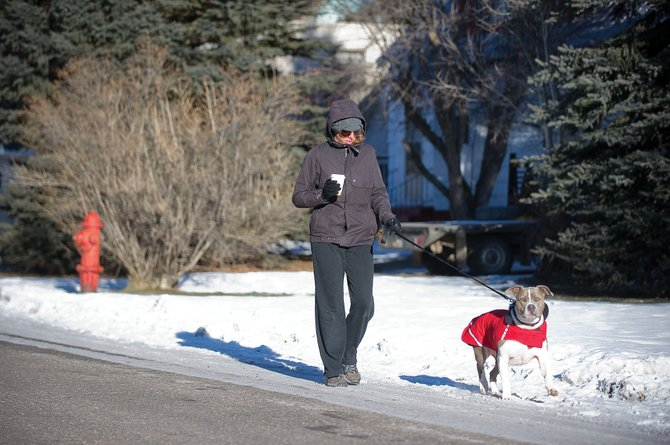 Steamboat Springs resident Lindsey Smith didn't let the low temperatures outside stop her from walking her pitbull Mako along Aspen Street on Tuesday morning.