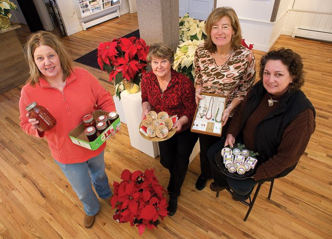 Local crafters, from left, Heather Philmon, Sandi Nelson, Tibby Speare and Joanne Churchill, are just a few of more than 35 vendors participating in this year's Holiday in the Rockies craft show. The event takes place all day Saturday at Bud Werner Memorial Library and the Depot Art Center.