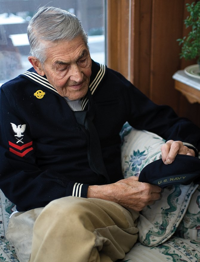 Veteran Omar Campbell recalls his days in the U.S. Navy while checking out his old uniform at his home in Steamboat Springs. Pearl Harbor is particularly meaningful for the World War II veteran who toured the South Pacific during the war.