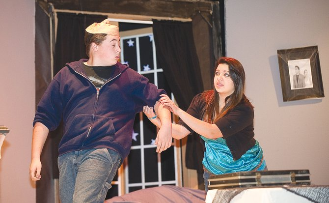 "Dylan Reedy, who plays the part of Durward, shares a scene with Faith Allen, who plays Judy, during a rehearsal for Hayden High School's production of ""Honeymoon at Graveside Manor."" Performances are 7 p.m. Friday and Saturday with a matinee at 1 p.m. Saturday."