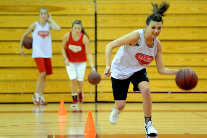 Steamboat's Megan Stabile races down the floor during a drill Wednesday. The boys and girls Steamboat Springs High School basketball teams begin play Thursday in the Steamboat Springs Shoot-Out. The Boys play at 6:30 p.m. and the girls at 8:15 p.m.