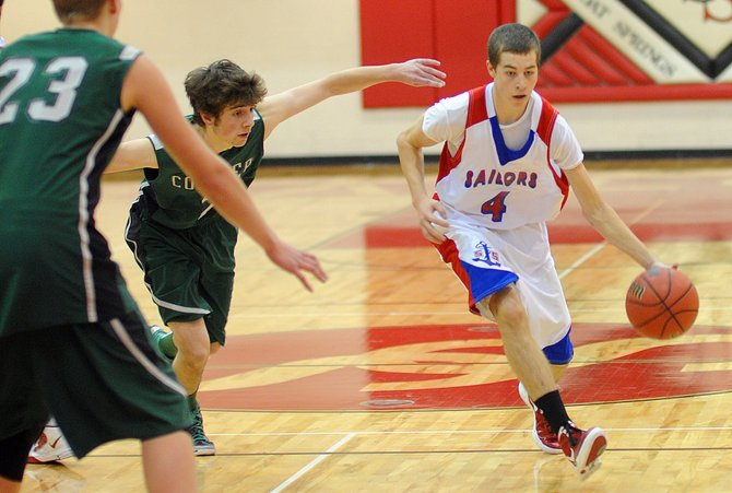 Steamboat Springs High School&#39;s Justin Ditter drives down the court Thursday as the Sailors rolled over Conifer in the opening round of the Steamboat Springs Shoot-Out.