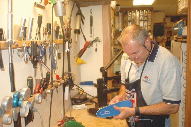 John Kole works on a customer's custom insole this week at One Stop Ski Shop in downtown Steamboat Springs.