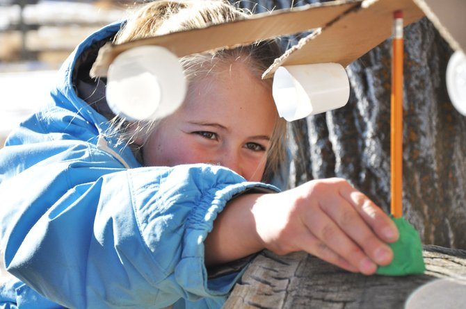 Hayden Elementary School fifth-grader Allison Ingols-Irwin measures wind speed with a turbine she made with her classmates Wednesday at Carpenter Ranch. The students spent the day studying renewable energy sources with Yampatika naturalists.