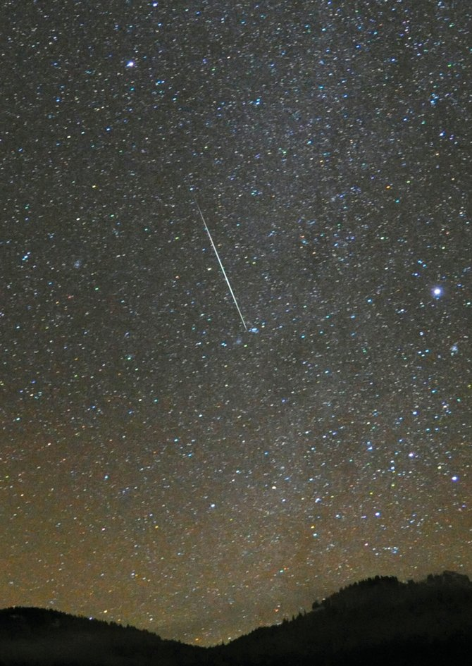 The bright streak in this image was made by a Geminid meteor burning up in the Earth's atmosphere about 60 miles high. Although the moon will hamper visibility for tonight's meteor shower, there should still be lots of bright meteors visible through the moonlight tonight and into Wednesday morning.