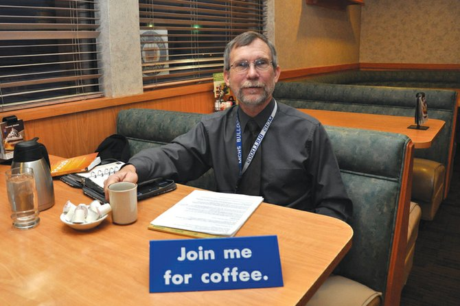 Thom Schnellinger, Moffat County High School principal, sits early Thursday morning at Village Inn during a Coffee With the Principal session, a semi-monthly event he recently started. The event is designed to gather feedback from parents and the public.