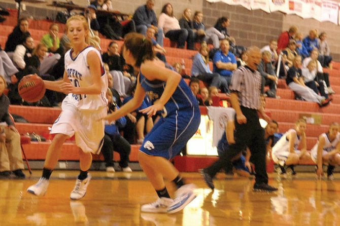 Bailey Hellander, a Moffat County High School junior, drives into the lane Saturday against Fruita-Monument High School during the Black Canyon Classic at Montrose High School. The MCHS girls varsity basketball team took the lead early in the fourth quarter and never trailed again, beating Fruita, 49-45, to finish the weekend 3-0.