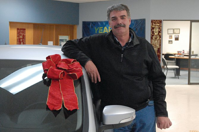 The late Steve Deyo, a Craig resident and businessman, leans on a 2012 Ford Focus on the sales floor at Craig Ford, 801 W. Victory Way. A memorial service for Deyo, who died Jan. 17, took place Sunday. A profile on Deyo appeared in the Dec. 19, 2011, Craig Daily Press and reappears today in memory of him.