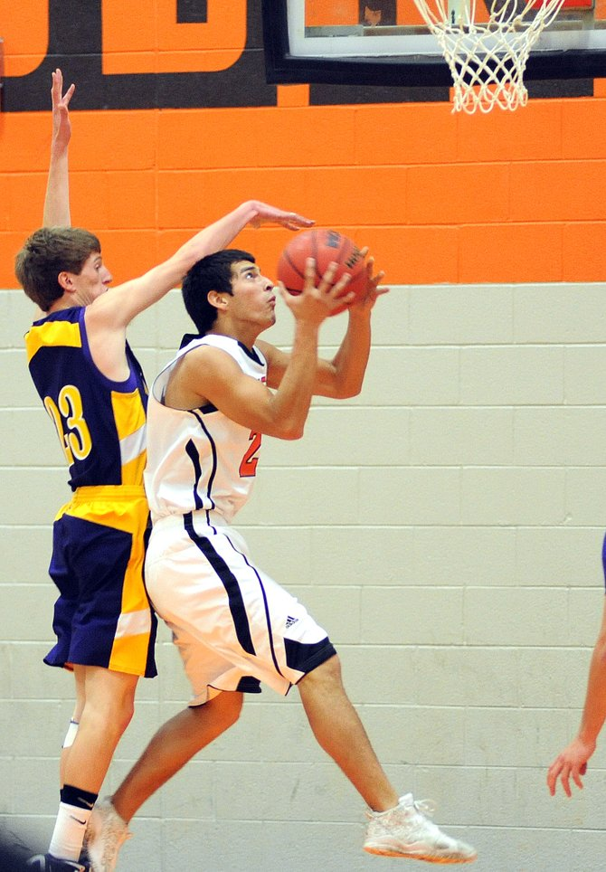 Hayden&#39;s Jorge Valdez goes up for a shot on Saturday against Little Snake River.