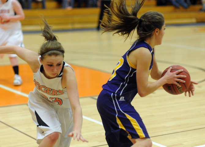 Haydens Brette Fentress dives to try to foul a Little Snake River player Saturday. The Tigers lost to the Rattlers in overtime.