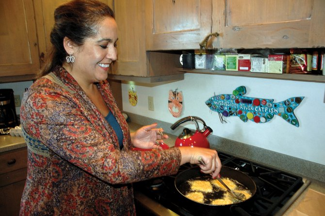 Steamboat Springs resident Paula Salky makes potato latkes in her home Tuesday. Salky, a member of the Jewish congregation Har Mishpacha, will be making dozens more for a Hanukkah celebration at 6 p.m. Friday at Bud Werner Memorial Library.