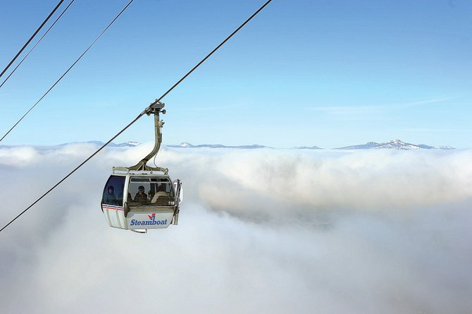A gondola car rises above the clouds that blanketed the valley floor Tuesday morning in the Yampa Valley. Later in the afternoon, the clouds gave way and blue skies dominated the view not only from the slopes of Steamboat Ski Area but also across Steamboat Springs.