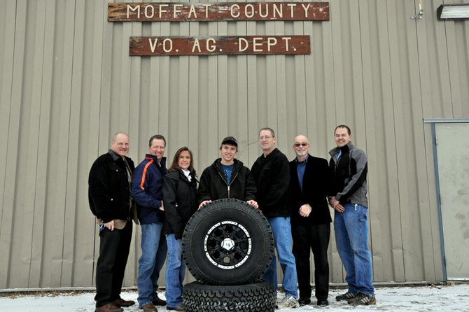 Moffat County High School educators, school district administrators and representatives from Chapman's Automotive came to the high school's vocational ag building Wednesday morning to congratulate Cody Cox, center, an MCHS senior, for being the top seller in the FFA program's annual fundraiser. Pictured from left are Assistant Superintendent Brent Curtice, Chapman Automotive co-owners J.B. and Paula Chapman, Cox, MCHS agriculture education teacher John Haddan, Superintendent Joe Petrone and ag teacher Rick Murr.