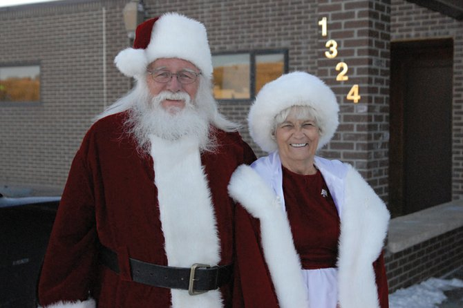 Santa Claus and wife Mrs. Claus stop to chat on their way to visit the eager children of the Boys & Girls Club of Craig. They will be visiting several Craig locations today before Santa makes his nighttime deliveries to people around the world.