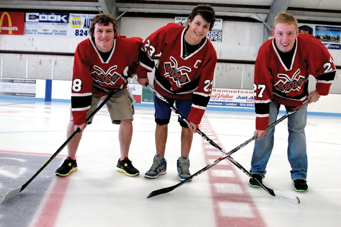 Moffat County High School juniors, from left, Michael Samuelson, Jarrett Walt and Bubba Ivers are bypassing playing on the Moffat County Bulldogs club hockey team this season in favor of competing on the Steamboat Springs High School team. Samuelson said the chance to play for a high school team and in a competitive league was the best opportunity for him to improve his game.