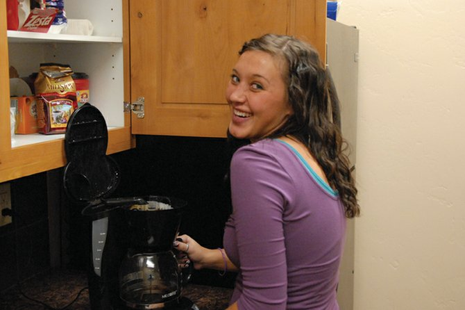 Loan administrator Whitney Showalter prepares a pot of coffee in the employee breakroom at Yampa Valley Bank. Showalter, 22, said she enjoys her job because it helps people achieve their dreams.
