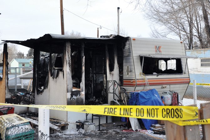 Firefighters responded Christmas morning to a fire at a trailer, pictured above, in the 600 block of East Fourth Street. Charles Hurtt, 54, and Frances Burkleo, 63, were living in the trailer and died in the fire. Memorial services are pending.