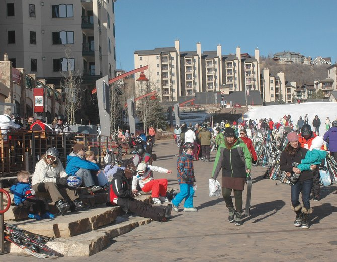 Holiday visitors soaked up the December sun Monday along the new promenade at the base of Steamboat Ski Area.