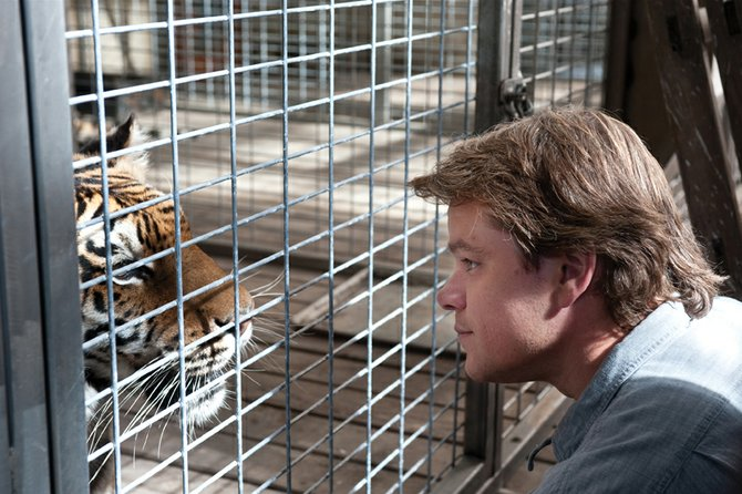"Benjamin Mee (Matt Damon) goes face to face with Bengal tiger Spar in ""We Bought a Zoo."" The film is about a widowed father of two who starts down a new life path with his children."