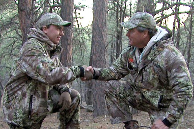 "Craig Conrad, right, shakes hands with Jake Bullock on the first episode of ""Wyoming's Call of the Wild,"" a nature show hosted by Conrad. Conrad, a former Moffat County High School teacher, said being able to experience hunting and fishing with youths for the first time has been an amazing experience."