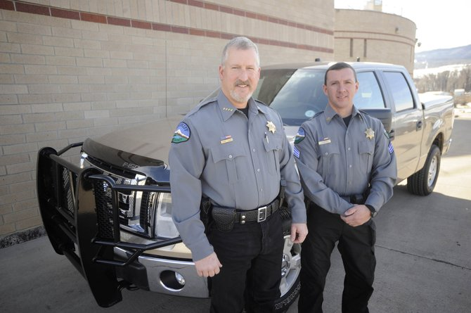 Routt County Sheriff Garrett Wiggins, left, and Sgt. Doug Scherar model the new uniforms being worn by deputies.