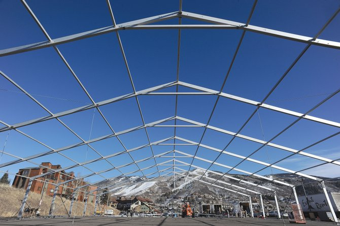 Crews work to construct the frame of a large tent for the annual MusicFest in the northwest portion of Knoll parking lot off Mount Werner Circle. MusicFest is a package travel tour that draws thousands of fans of the Texas Americana music genre for six days of concerts with 40 bands, parties and skiing. This year's MusicFest begins  Thursday, and a portion of the parking lot will be closed through Jan. 13.