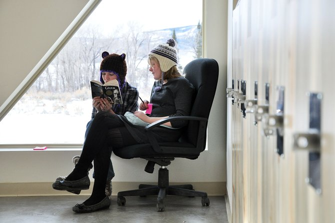 Madison Cosgrove, right, and McKinley Muhlbauer read together Wendsday at North Routt Community Charter School. The students on Wednesday started classes inside a brand new building.