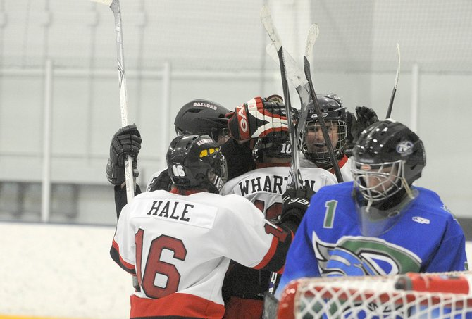 Members of the Steamboat Springs High School hockey team celebrate after scoring against the Pine Creek Eagles on Friday night at Howelsen Ice Arena. The Sailors won, 4-0.