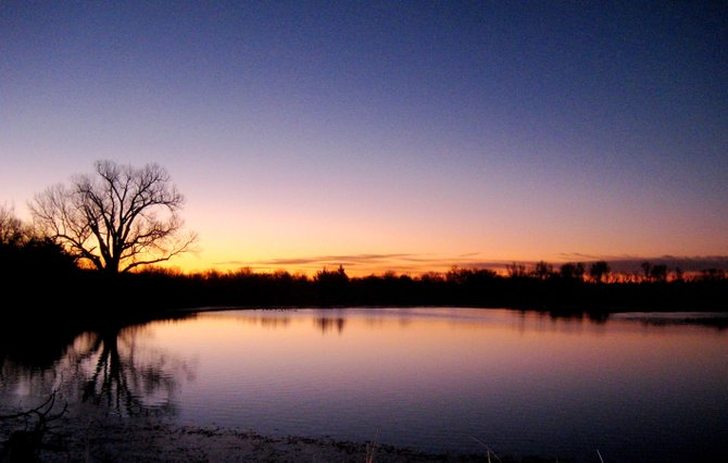 The sun rises over a secluded pond in Kansas on Dec. 28. The pond long has been a popular site for local hunters, outdoorsmen and families.