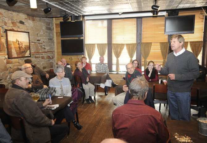 U.S. Rep. Scott Tipton, R-Colo., visits with constituents Saturday at Steamboat Smokehouse.
