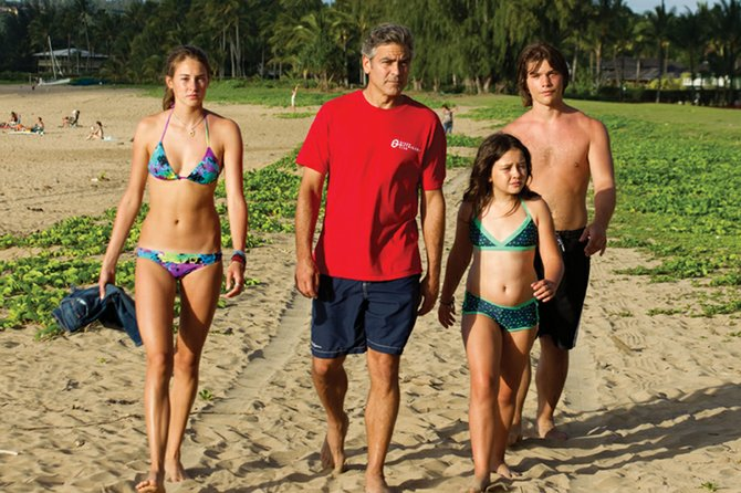 "Patriarch Matt King (George Clooney) strides across the Hawaiian beach with daughters Alexandra and Scottie (Shailene Woodley, Amara Miller) and family friend Sid (Nick Krause) in ""The Descendants."" Clooney plays a wealthy lawyer who is put in a tight spot when he learns his comatose wife was seeing another man."