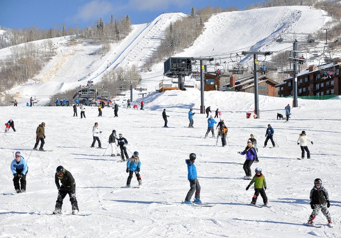 Skiers and snowboarders take advantage of 6 fresh inches of snowfall Sunday at Steamboat Ski Area.
