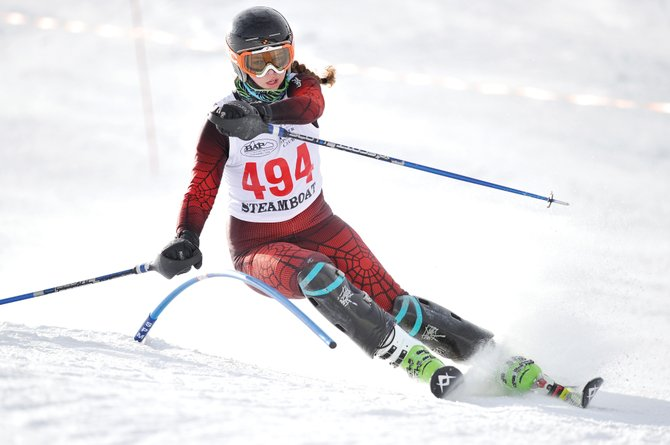 Steamboat Springs High School skier Suzanne Lyon pushes a gate out of the way while making her way down the slalom course at Howelsen Hill during Friday's high school race. Lyon won the women's race, and teammate Connor Bernard topped the men's field in the race hosted by Steamboat Springs High School.