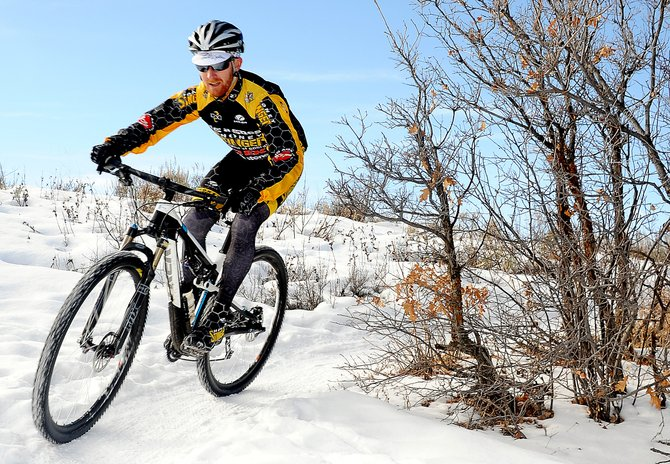 Steamboat Springs cyclist Nate Bird swings around a corner Friday while riding on Emerald Mountain. Mountain bikes aren't a rare sight on the mountain in the winter, but the lack of snow this season has led to a big jump in locals riding the snowy singletrack.
