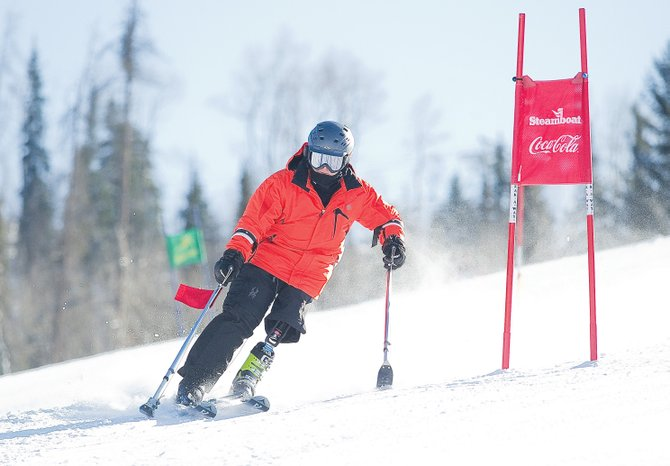 Dennis Walburn, an Army veteran who lost a leg in an explosion in Iraq, attended the Steamboat Adaptive Recreational Sports camp this week at Steamboat Ski Area. With a special prosthetic he uses for skiing and an adaptive, two-ski system he designed, Walburn easily navigated Steamboat's NASTAR race course Thursday.